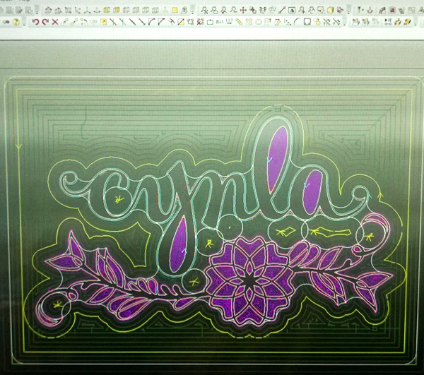 Cynla logo in the program before it's cut into a wooden sign - tech geek image