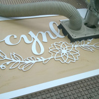 wooden Sign cutting for a tradeshow booth - Cynla Logo
